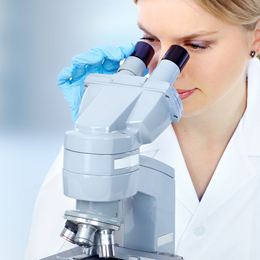 Doctor woman  working with a microscope Scientific Microscope. Medical health care research concept background.